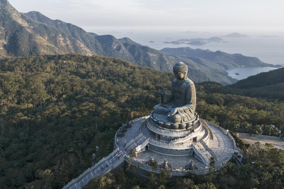 Aerial View Of Hong Kong Tian Tan Buddha At Dusk coronavirus travel meditation