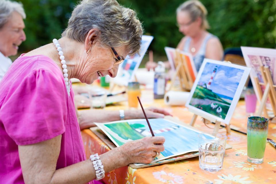 Senior woman in drawing class at an assisted living community