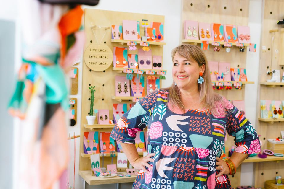 Mature woman business owner in store