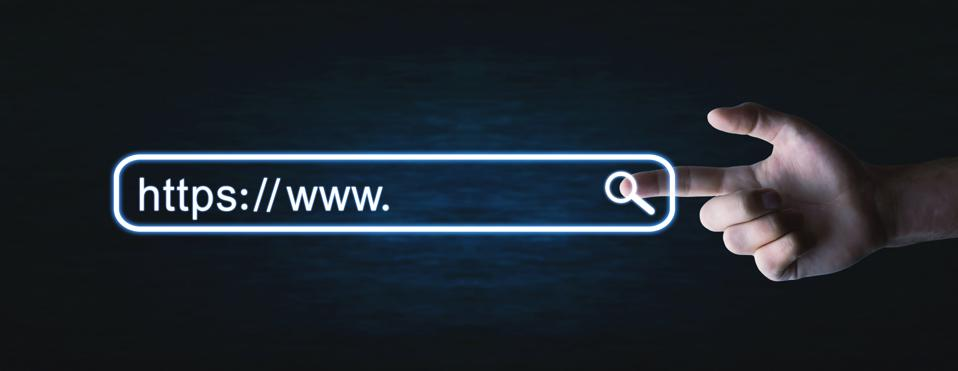 Male hand pressing https address. Internet search concept