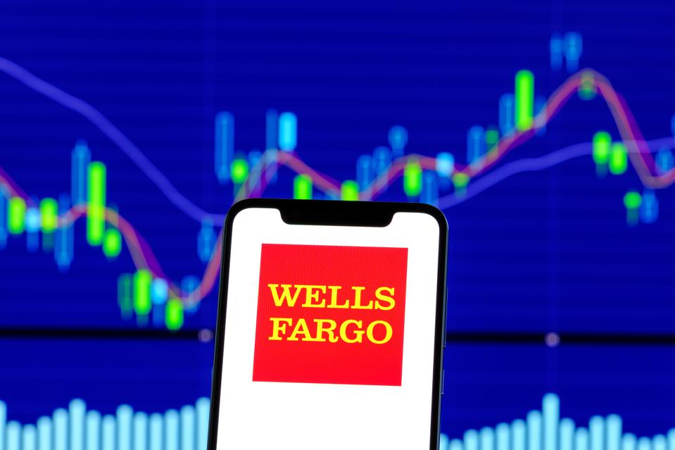 Wells Fargo logo is seen on an android smartphone over stock
