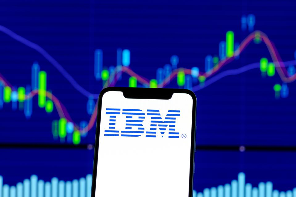 IBM logo is seen on an android smartphone over stock chart