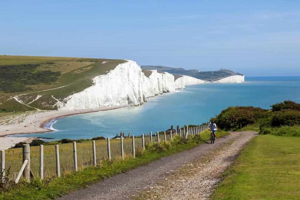 Cliffs, cyclist and beach