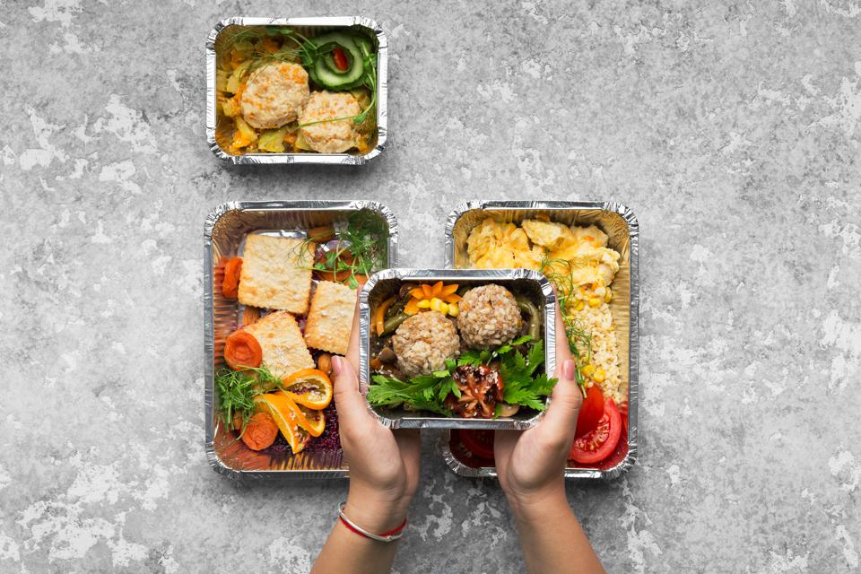 Foil containers of food.
