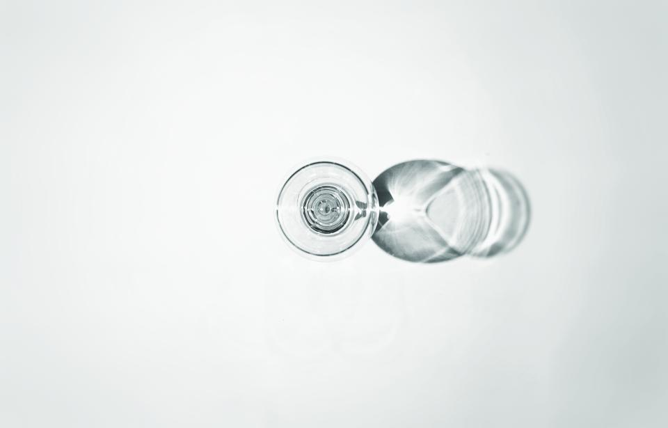 Directly Above Shot Of Drink In Wineglass Over White Background