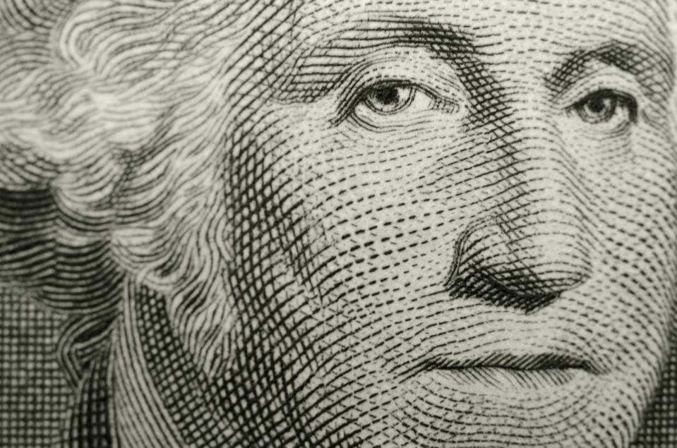 Slightly off axis, shallow focus close up, of president George Washington, from obverse of American one dollar bill.
