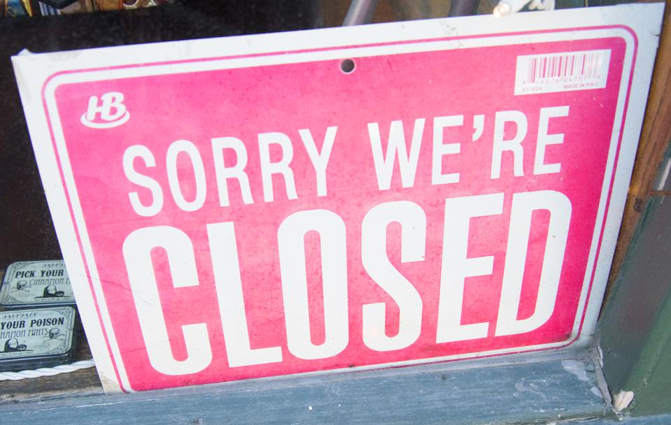 Sign in Store Window, Sorry Were Closed
