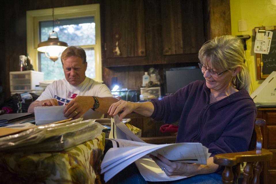 family discussing paperwork business