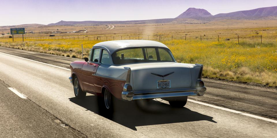 Vintage 1957 historic Chevrolet drives through remote Texas Landscape
