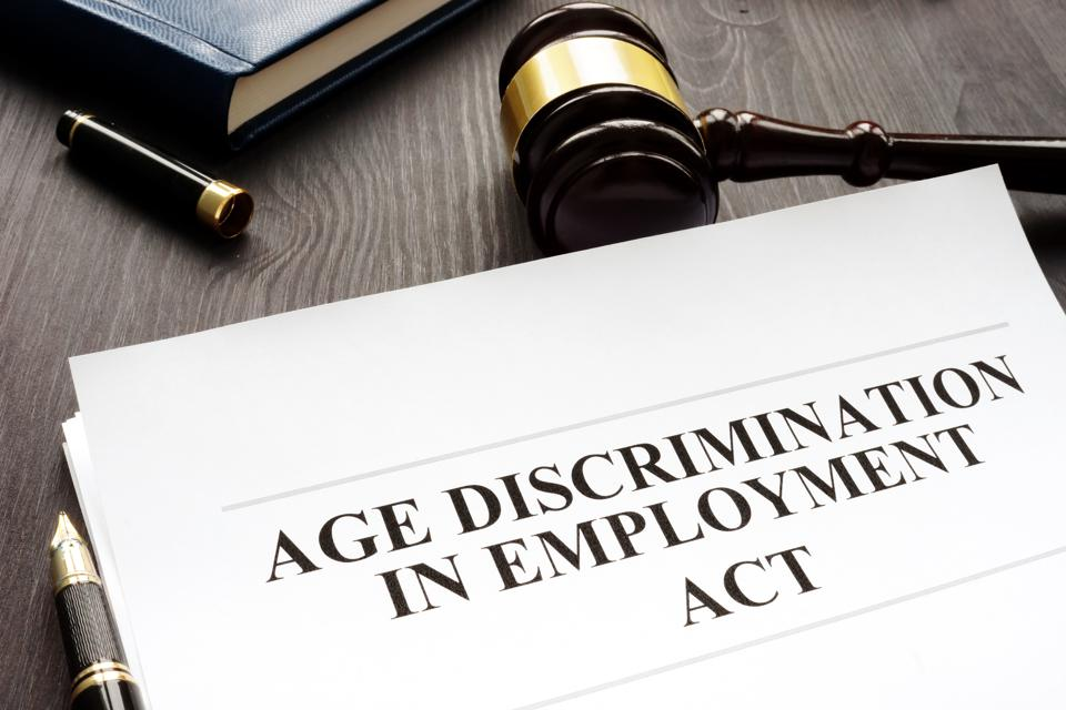 Fighting Age Discrimination in Employment Act and gavel in a courtroom.
