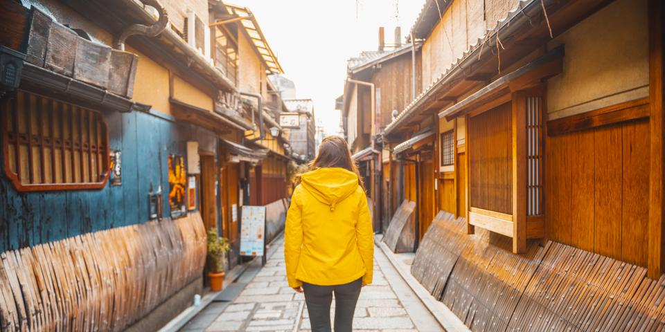Tourist woman walking in Gion district, Kyoto, Japan