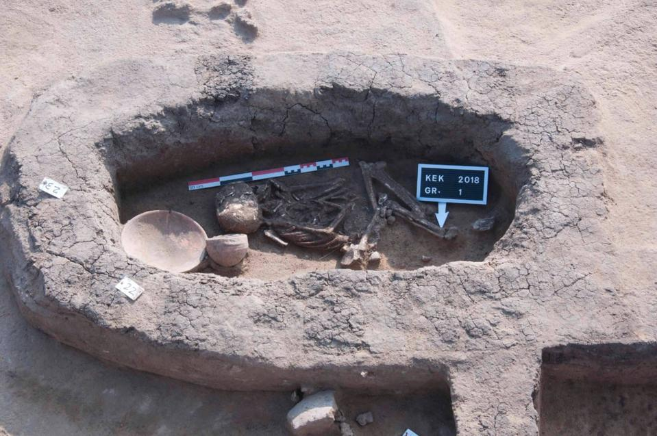 Ancient tomb and skeleton with some pottery discovered in Egypt.