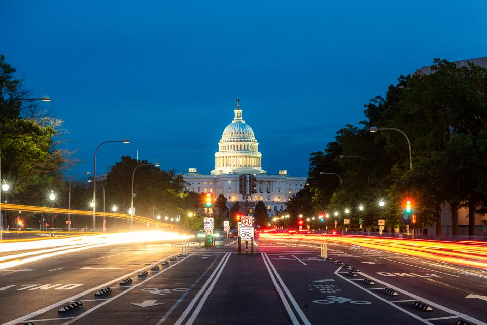 The United States Capitol building at night in Washington DC, USA. Do you know your airline rights?