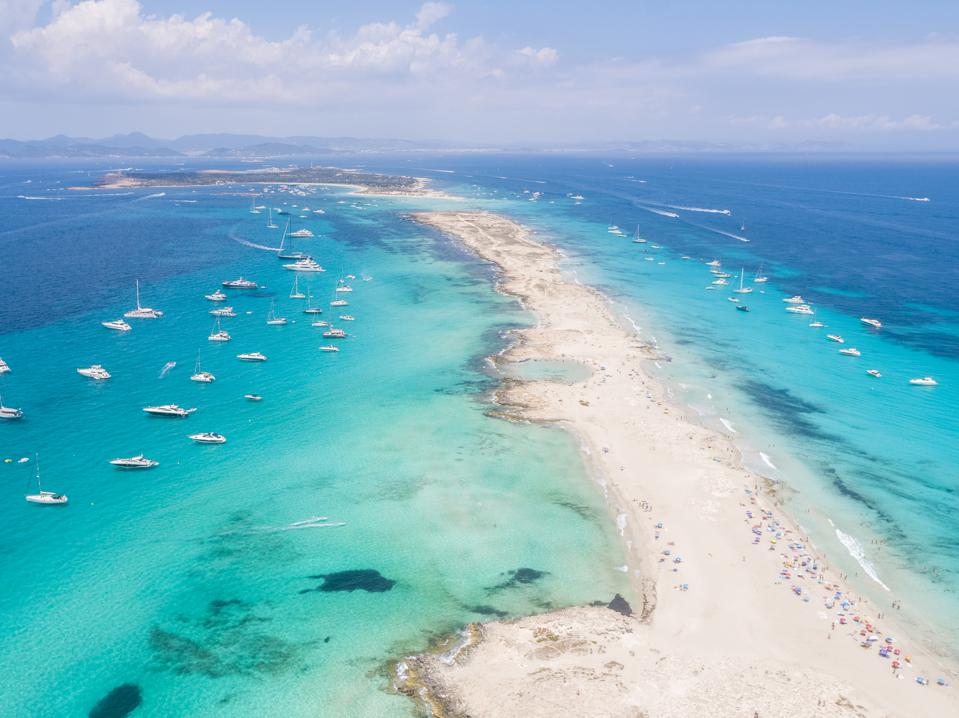 Formentera aerial view of turquoise water and yachts anchored