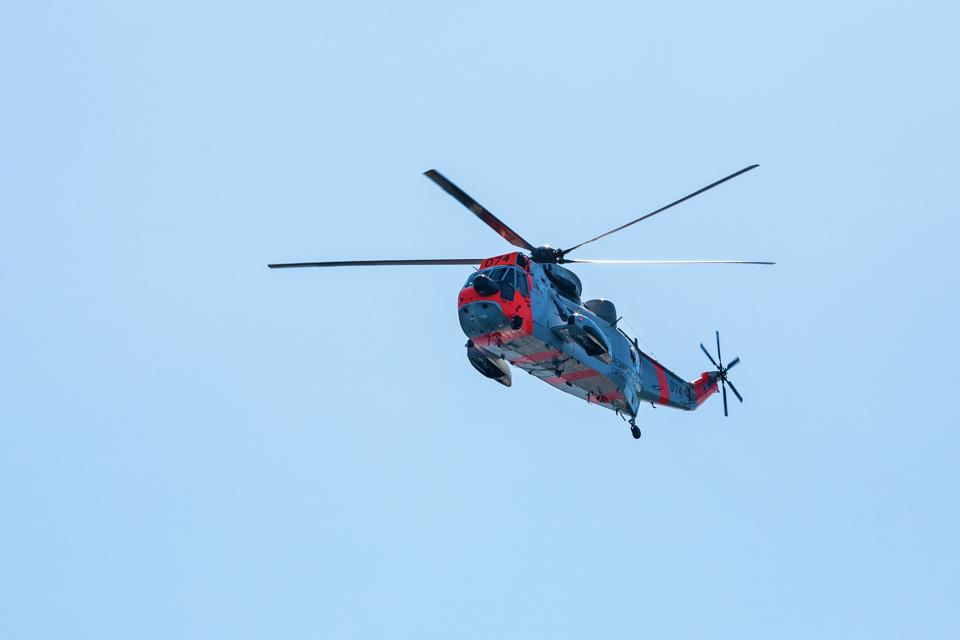 Rescue helicopter flying in the blue sky