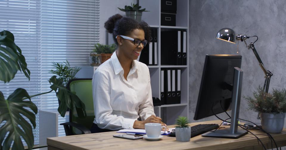 Young woman video chatting in office