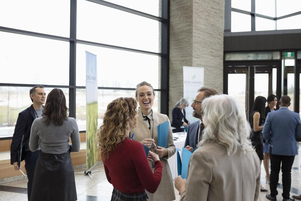 Business people networking at conference