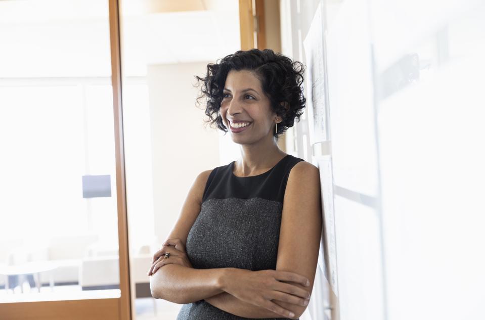 Portrait confident, smiling businesswoman in office