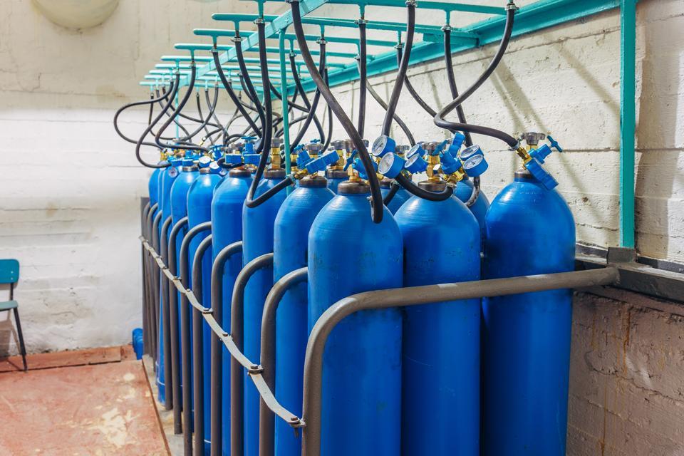 Bundle of blue gas cylinders with pressure gauges