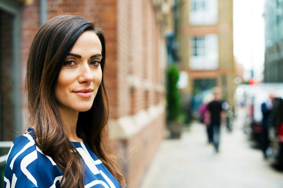 Woman looking at camera with subtle smile