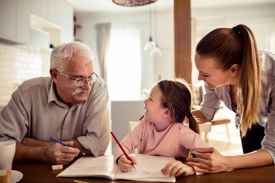 Grandfather teaching granddaughter.