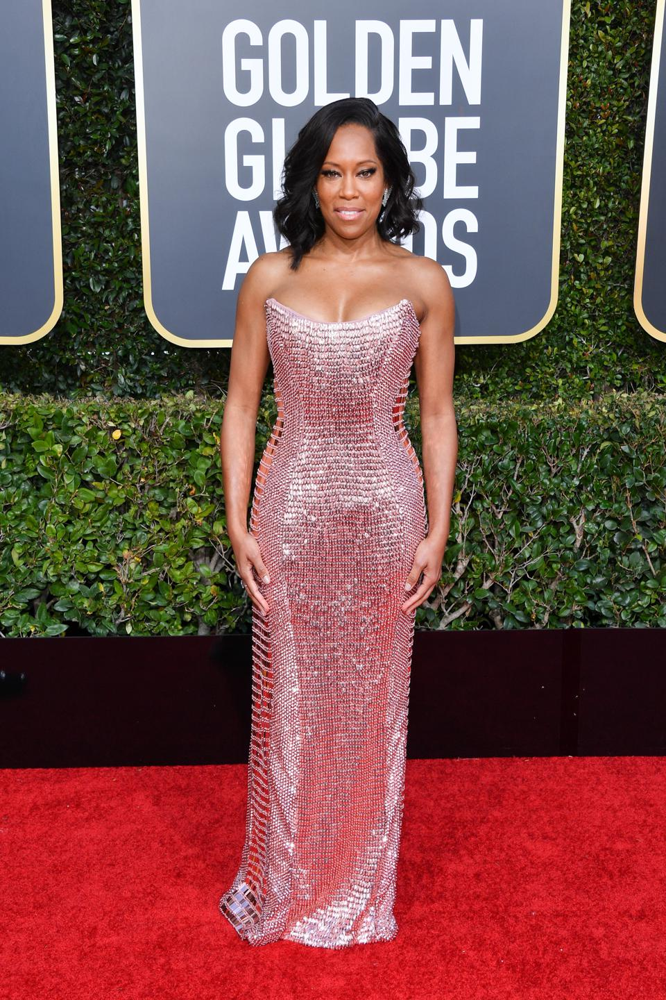 Regina King shows off her curves in a pink gown by Alberta Ferretti.