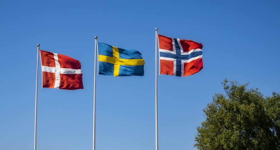 The flags of Denmark, Sweden and Norway.