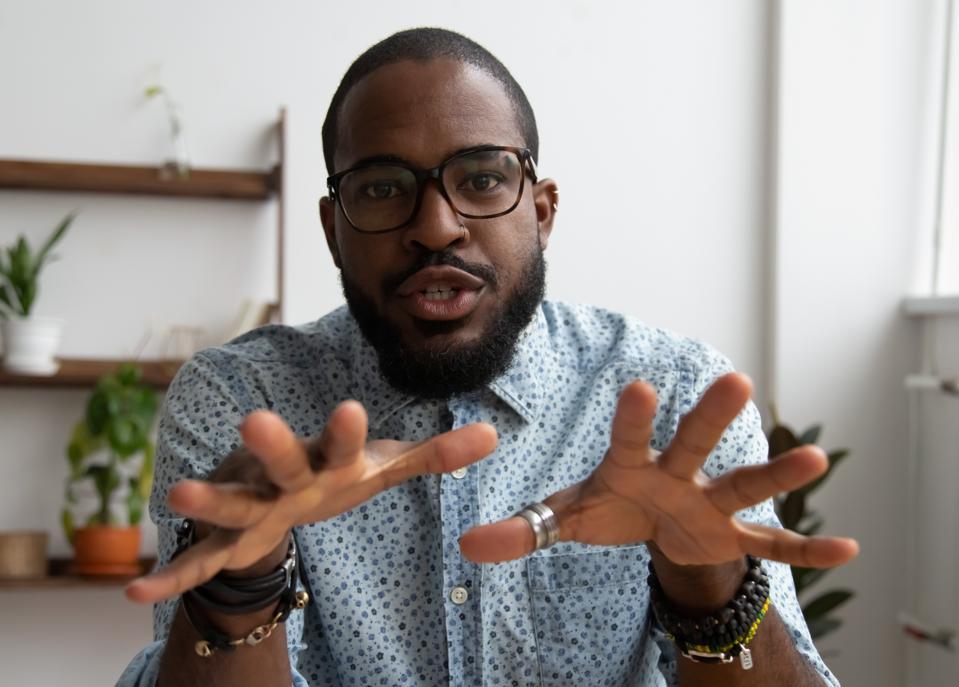 African entrepreneur recording video for online webinar
