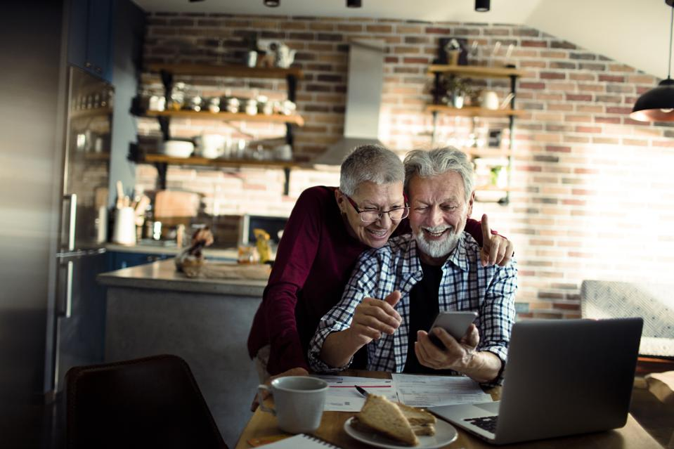 Senior couple using a phone