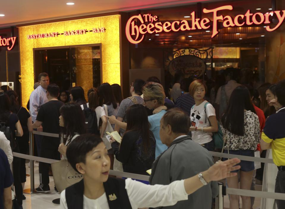 People queue up for the The Cheesecake Factory. (Photo by May Tse/South China Morning Post)