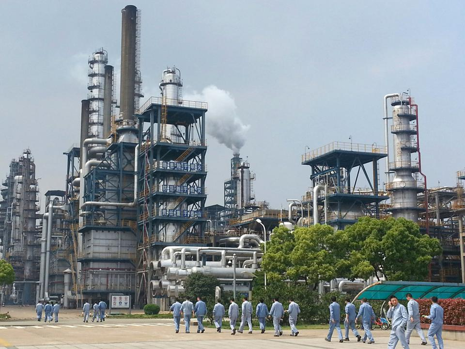 Workers walking across Sinopec's second largest oil refinery and petrochemical complex in Zhenhai, Ningbo, which has an annual capacity to refine 23 million tonnes of crude oil and produce 1 million tonnes of base chemical ethylene. 20APR17 SCMP / Eric Ng