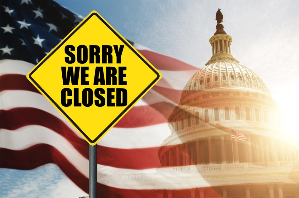 Sing saying Sorry We Are Closed in front of a U.S. flag and the Capitol building.