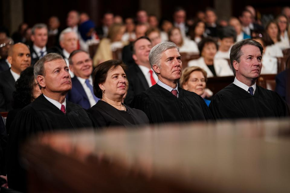 Supreme Court Justices John Roberts, Elena Kagan, Neil Gorsuch and Brett Kavanaugh attend the State of the Union address February 5.