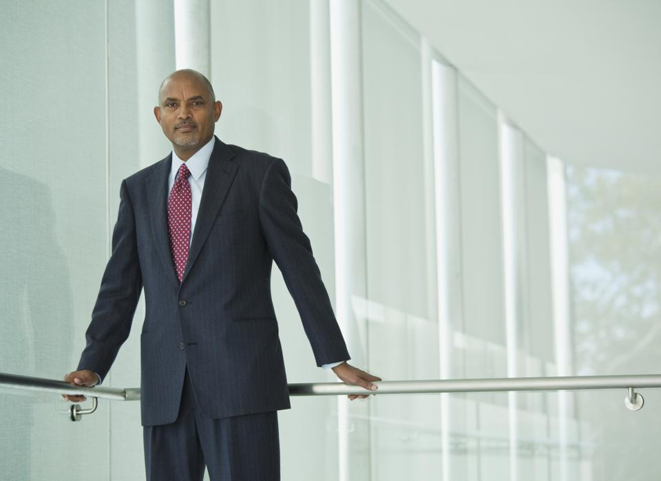 Serious African American businessman leaning on railing