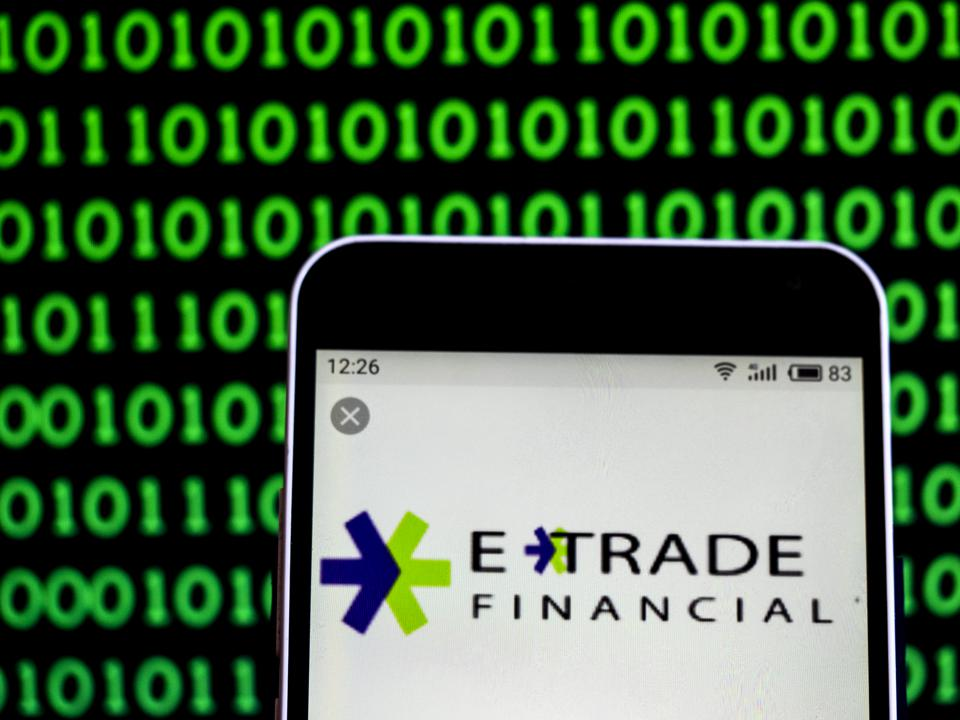 E-Trade Financial services company  logo seen displayed on a