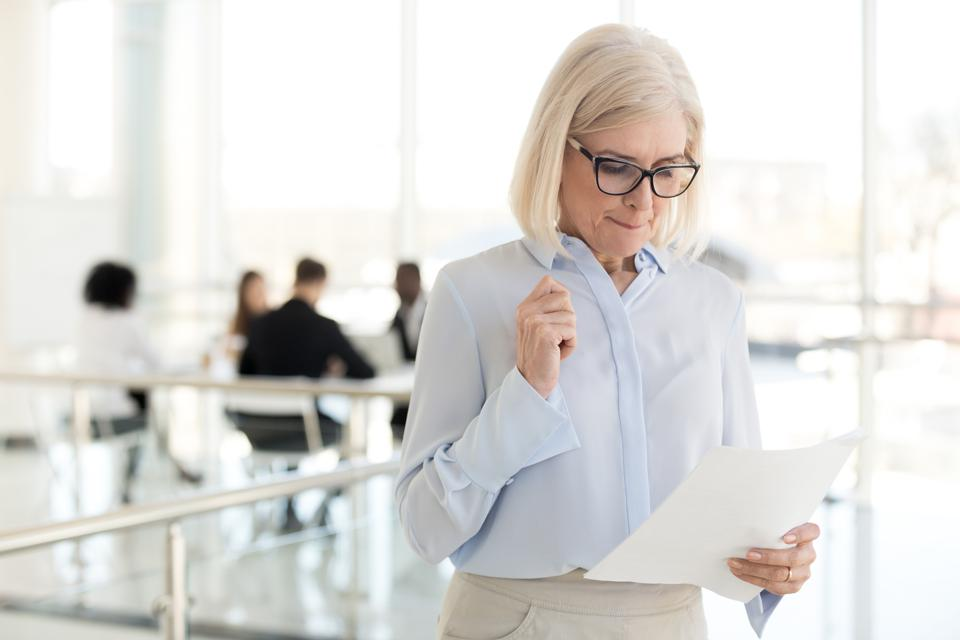 Nervous middle-aged businesswoman feeling stressed afraid waiting for job interview