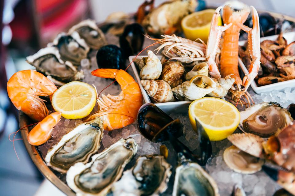Close up of fresh seafood on ice plate