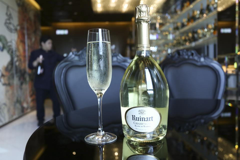 Glass of Ruinart Blancs de Blanc with bottle from The Champagne Bar at Mira Moon Hotel in Causeway Bay. 17JUN15   [BAR REVIEW 48HRS]