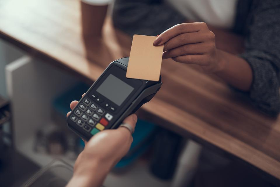 Laconic image of easy payment by card in the cafe