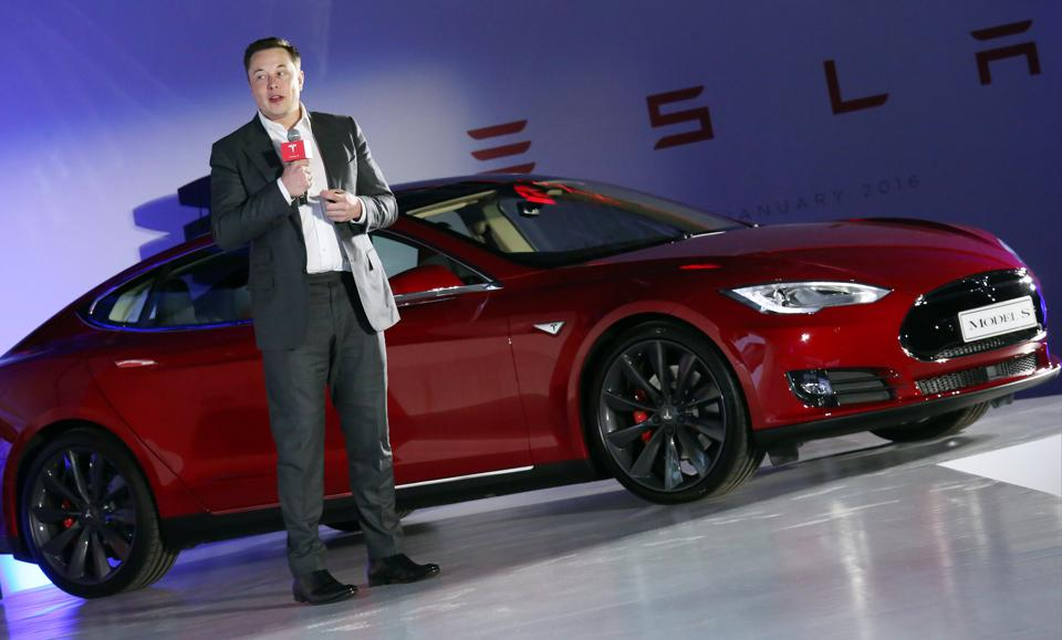 Tesla Motors CEO Elon Musk speaks to the media next to its Model S during a press conference in Hong Kong. 25JAN16  SCMP/ Nora Tam