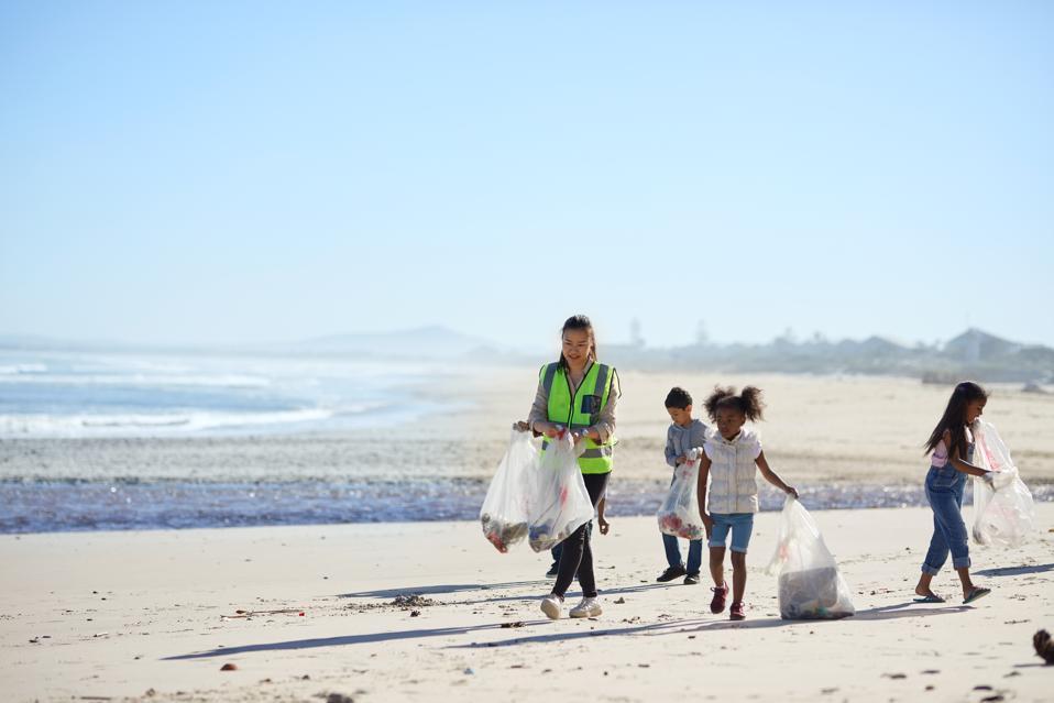 Children volunteers cleaning up beach litter
