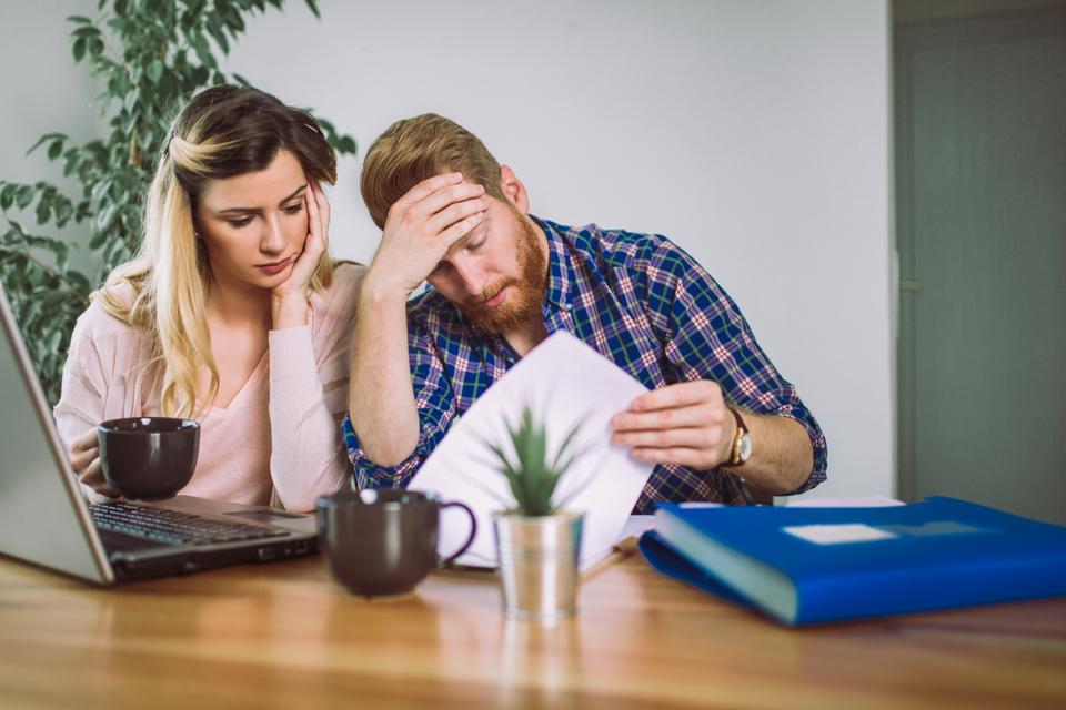 Woman and man trying to understand IRA eligibility