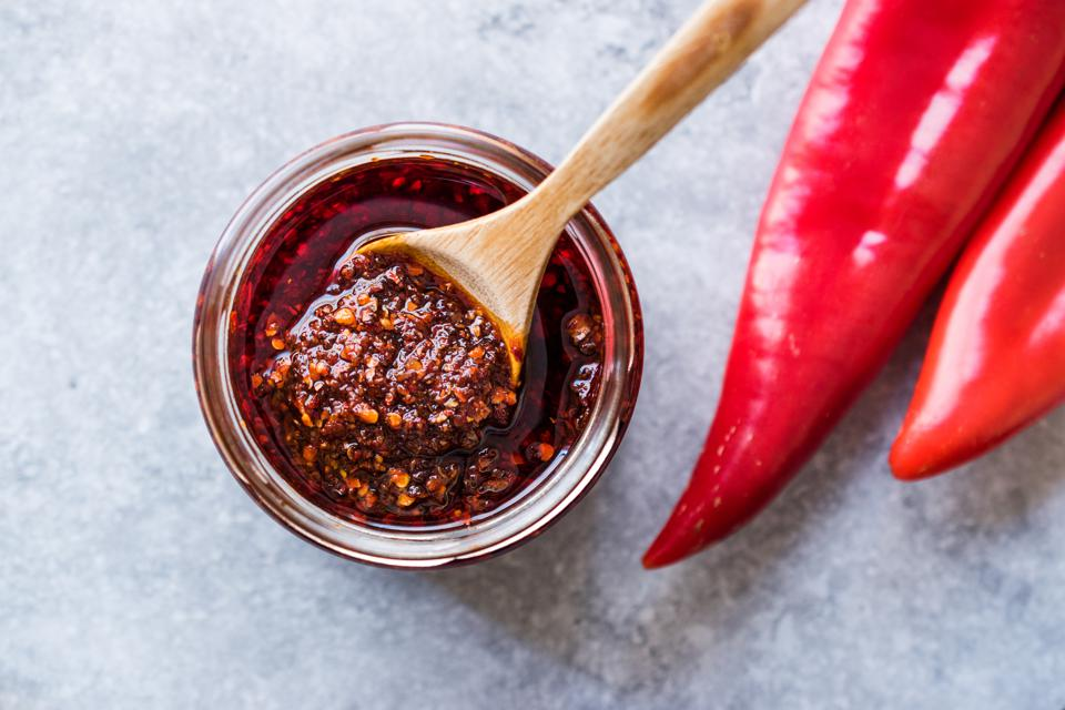 Hot Mexican Spicy Chili Red Sauce Salsa Macha with Red Pepper Powder in Jar.