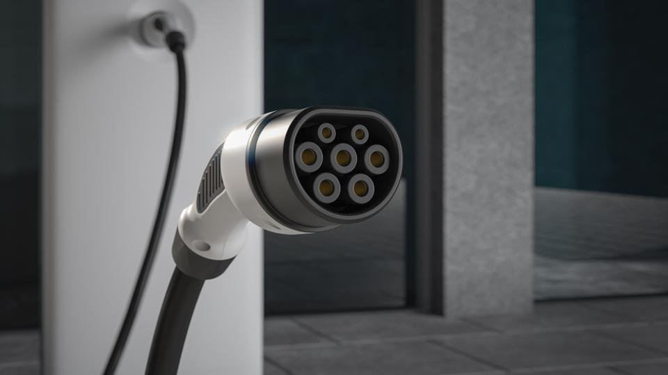 Close up of EV charging plug in a city environment close up 3d rendering