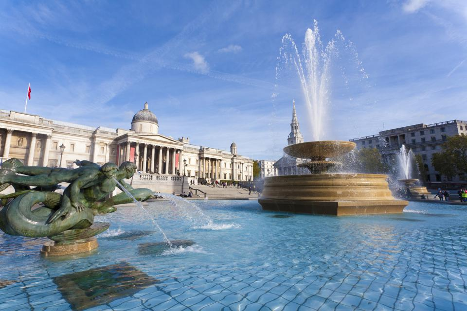 Great Britain, England, London, Trafalgar Square, View of fountain at national gallery museum