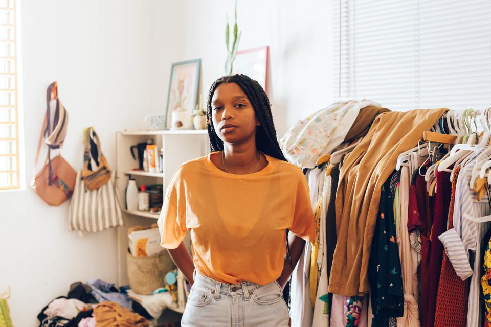 Young woman standing in room