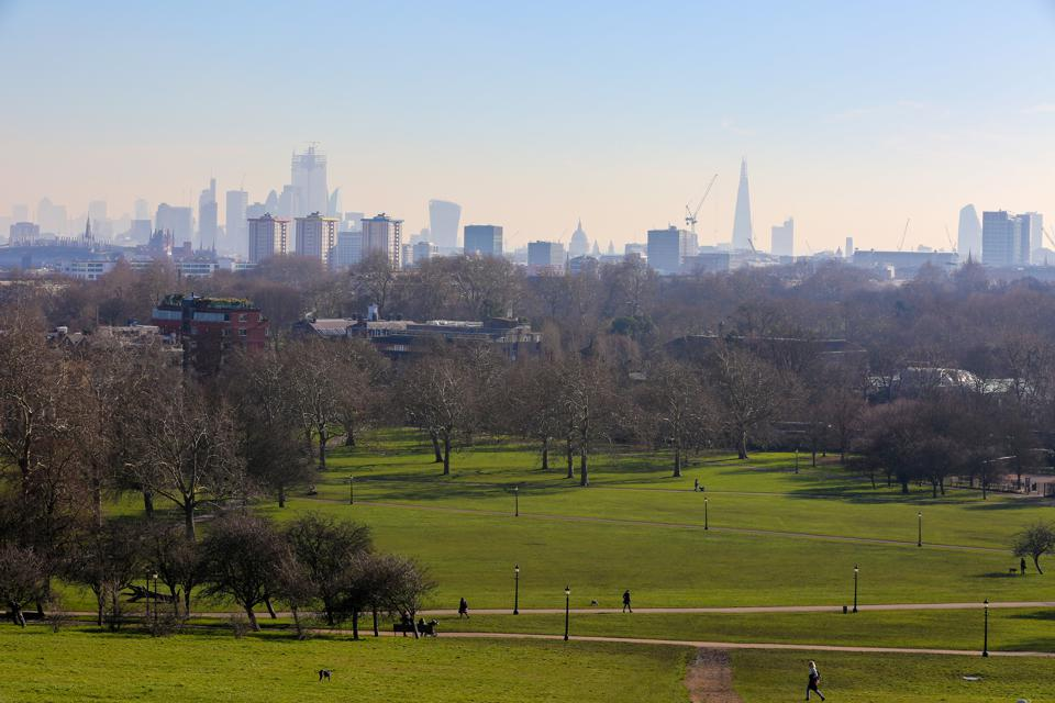 Tourists and Londoners are seen on Primrose Hill during a...