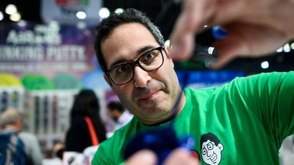 Aaron Muderick, founder of Crazy Aaron's, shown at the 2019 Toy Fair stretching some of his Thinking Putty toy.