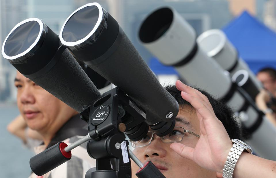 Citizens gather in Tsim Sha Tsui to watch the transit of the planet Venus across the face of the sun.06JUN12