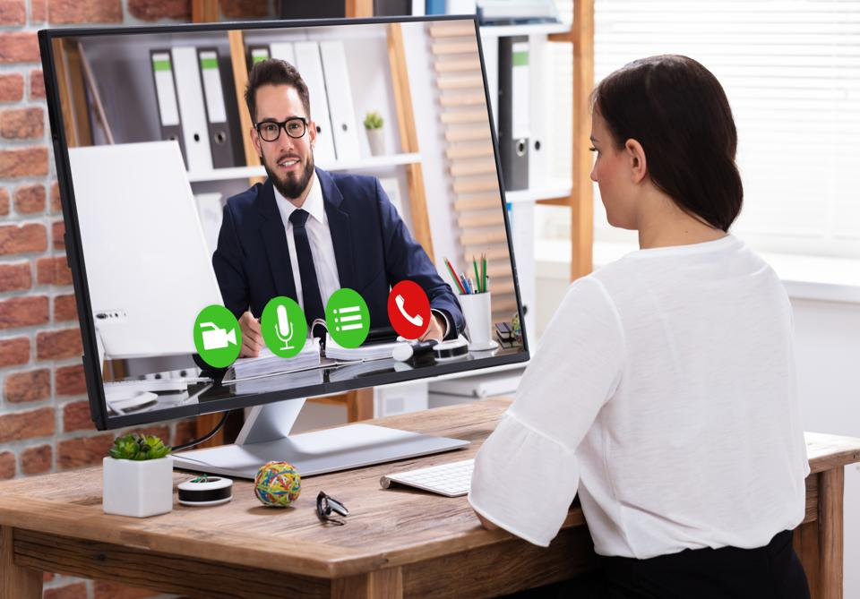 Businesswoman Video Conferencing With Businessman
